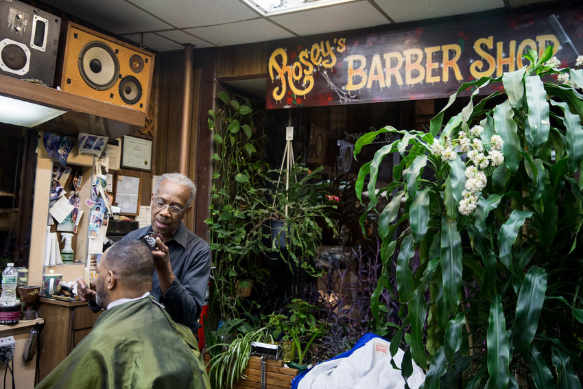 Roosevelt Spivey shaves J. Loren Russell's hair in Marble Hill's International Unisex Salon, known to patrons as Rosey's Barber Shop. Spivey's salon is facing an uncertain future after learning his shop rent is jumping $1,500 a month.