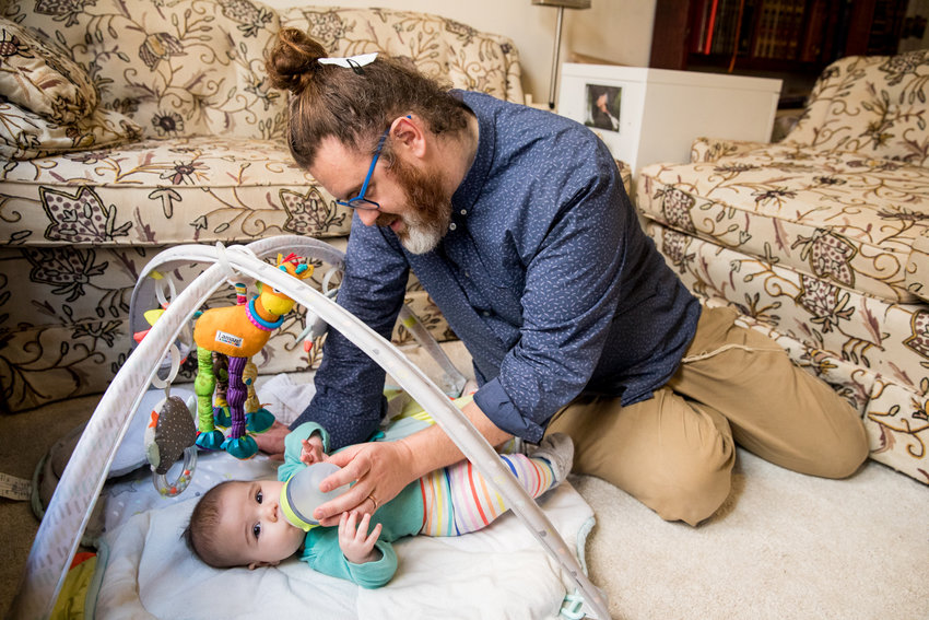 Phreddy Nosanwisch feeds his daughter Erev Willow in their Washington Heights home. Nosanwisch became a parent around the time he started teaching at the Conservative Synagogue Adath Israel of Riverdale two years ago, and is one of this year's recipients of the Jewish Education Project's Robert M. Sherman Young Pioneers Award.