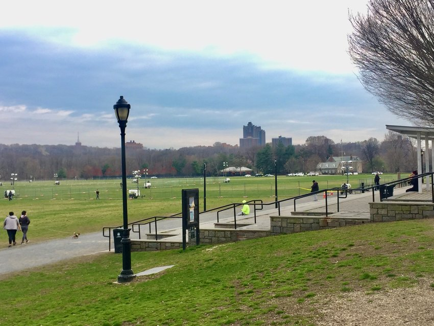 The U.S. Army Corps of Engineers and FEMA erect fencing on the southern third of the Van Cortlandt Park Parade Grounds on Sunday, in preparation for a 200-bed COVID-19 field hospital planned there.