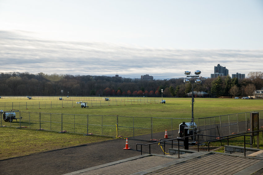 Fencing surrounds the southern third of the Van Cortlandt Park Parade Grounds, which will be the site of a 200-bed COVID-19 field hospital, intended to relieve already at-capacity city hospitals.