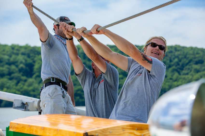 Gabriel Peterson, right, leads a group of crewmembers tacking the mainsail aboard the Pioneer schooner at RiverFest. Because of the coronavirus pandemic, the organizers behind RiverFest have canceled this year's celebration of the Hudson River.