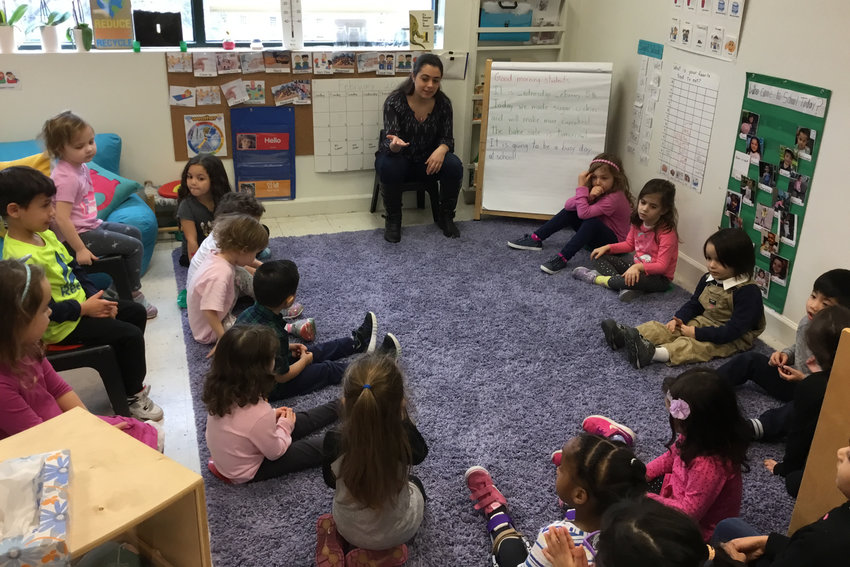 Taylor Aloisio teaches a room full of preschoolers at Riverdale Nursery School and Family Center in February. Aloisio's teaching was unpaid, as it was part of her coursework for her childhood education major at Manhattan College.