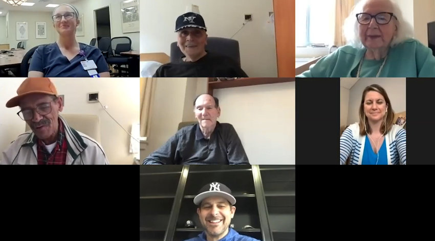 New York Yankees manager Aaron Boone, bottom, chats it up with some residents and nurses from the Hebrew Home at Riverdale in a Zoom videoconference call. Will the Yankees play again this season? Boone says that's a big yes.