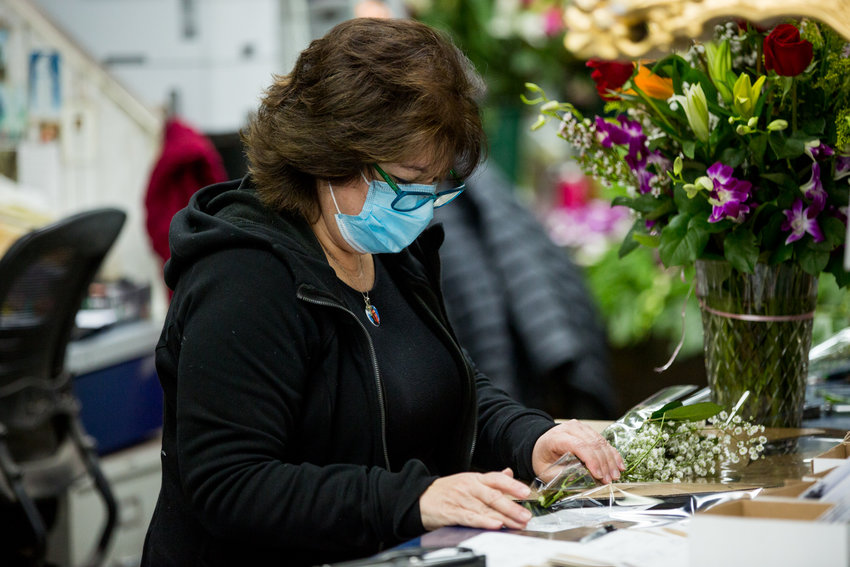 Columbia Florist co-owner Katherine Capsis prepares an order for a customer two days ahead of Mother's Day. The West 231st Street flower shop has managed to stay open even though many of its neighbors closed temporarily in the wake of the coronavirus pandemic.