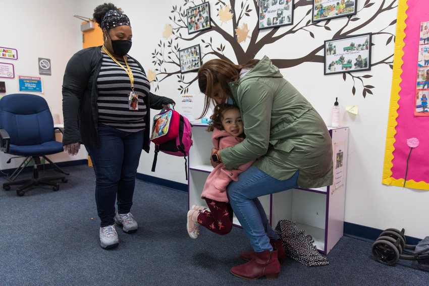 Roxana Vazquez hugs daughter Mia, who receives free day care at The Learning Experience on Riverdale Avenue. Vazquez works with young children as a clinical social worker.