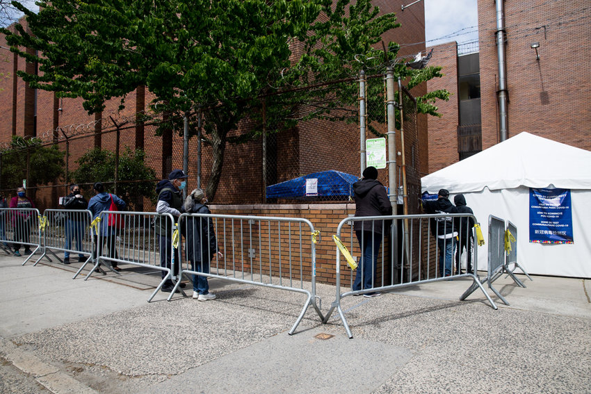 People wait in line to get tested for the coronavirus that causes COVID-19 at NYC Health + Hospitals/Gotham Health, Belvis — which is one of six diagnostic testing centers in the borough.