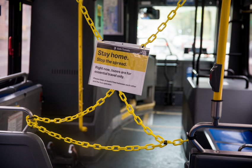 A sign hangs in front of a roped-off section of a bus informing passengers that buses citywide are for essential travel only. The city's bus network is one of the hardest hit areas of the MTA since the advent of the coronavirus pandemic, which has seen ridership plummet. Mayor Bill de Blasio has decided to defund the Better Buses Action Plan, intended to speed up bus service.