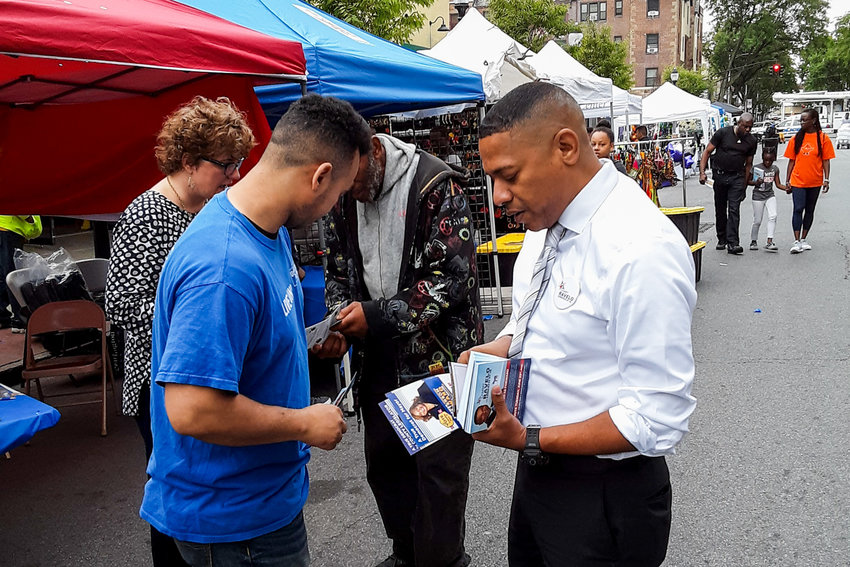 Sammy Ravelo, right, sifts through campaign materials as part of his bid to unseat U.S. Rep. Eliot Engel in the upcoming Democratic primary. Ravelo is in a crowded field of insurgent challengers alongside Andom Ghebreghiorgis and Jamaal Bowman.