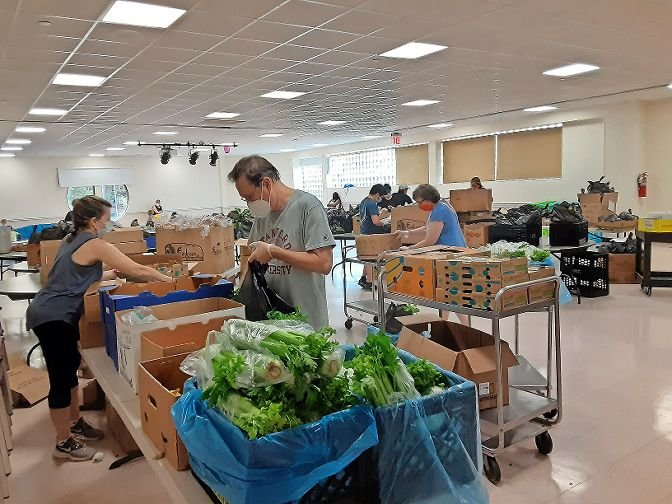 The Riverdale Y has a team of volunteers packing food and making deliveries to nearly 200 homebound senior citizens.