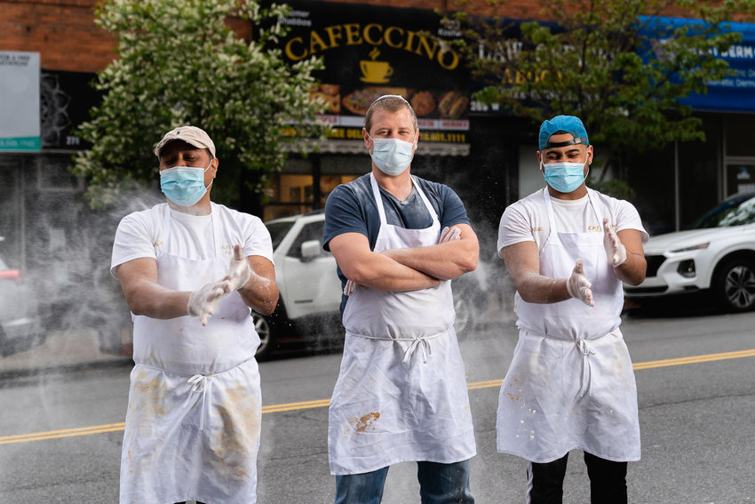 Lukasz Babiuch, center, is the owner of Cafeccino Bakery, which was featured as part of the Bring Back, Give Back Project, which aims to bring attention to local businesses and individuals who still provide services to the community despite the coronavirus pandemic.
