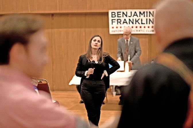 Alessandra Biaggi listens to an audience member's question at a 2018 endorsement meeting of the Benjamin Franklin Reform Democratic Club. Biaggi is leaving the political club to start a competing one.