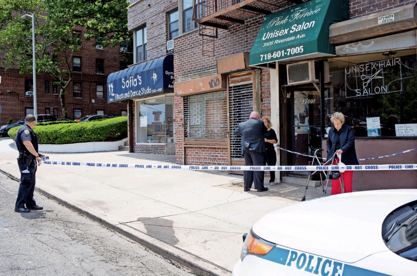 A police officer sets up a perimeter around the Park Terrace Unisex Salon on Riverdale Avenue during a robbery investigation in 2018. Crime has risen in some key categories, according to the New York Police Department, which they blame on bail reform.