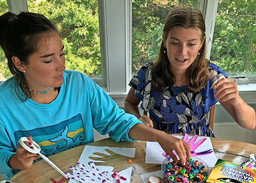 HomeBuddies Mentoring co-founders Katie Koch, left, and Cecilia Needham cut and color hand tracings during a group activity. HomeBuddies, a personalized mentorship program, was designed to provide children with remote mentoring during the height of the coronavirus pandemic.