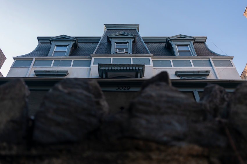 The stone wall separating the Moller Mansion from the sidewalk lining Godwin Terrace makes it hard for many to see the 150-year-old structure. Still, surrounded by more modern brick apartment buildings, this relic of the past has certainly looked out of place.