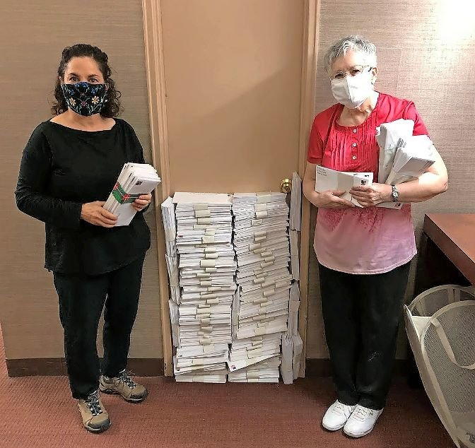 Miriam Levine Helbok, right, joins Kathy Solomon to show the 2,705 letters she wrote to voters in a half-dozen states that were mailed last week, urging them to vote Nov. 3. Solomon introduced Helbok to this particular get-out-the-vote project, launched last year by political group Vote Forward.