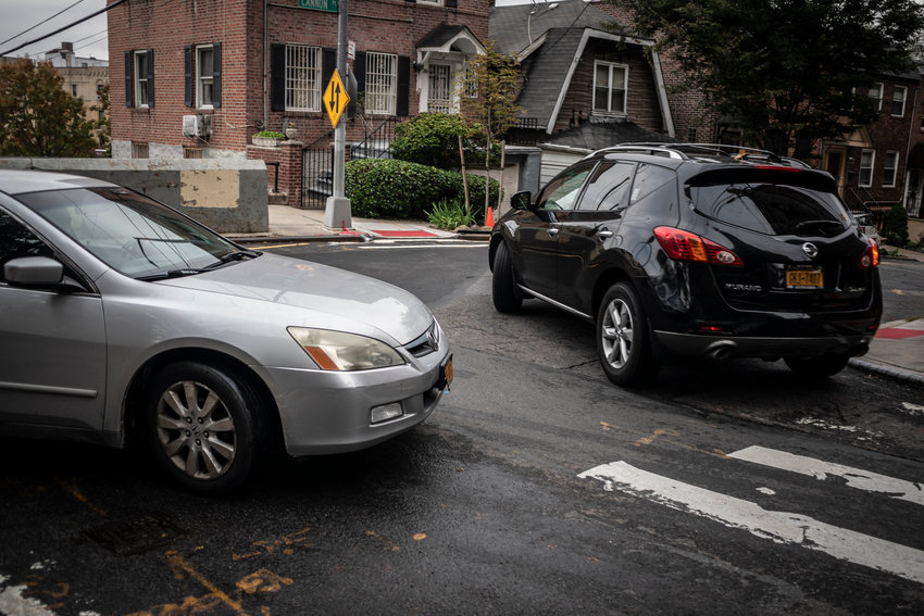 Two drivers barter for space at the mouth of West 238th Street between Cannon Place and Sedgwick Avenue. These three streets were at the center of a recent DOT study to convert this section of West 238th into a one-way street.