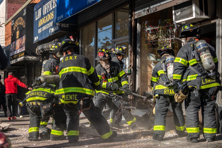 Firefighters pull rubble out of the Picture Perfect Frame store at 267 W. 231st St., on Monday afternoon. The entire interior ceiling collapsed on the shop and its owners, Nohad and Samia Jourdy. Luckily both escaped serious injury.