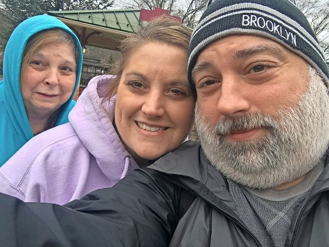 Just minutes before the train chugged into the Tyrone, Pennsylvania, station, Riverdale Press editor Michael Hinman poses in one last selfie with sister Renee Jovenitti and mother Rose Brendel.
