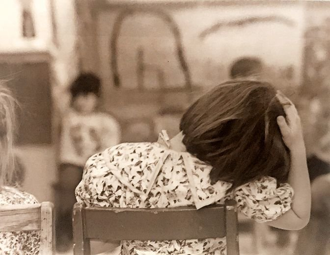 Samantha Lewin, 5, holds her head as her Kinneret Day School kindergarten class relives the Oklahoma City bombing tragedy in a story that published on May 4, 1995.