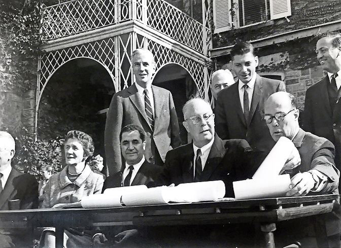 It was all made official on Nov. 4, 1965. City parks commissioner Newbold Morris arranges paper for the official signing creating what would become Wave Hill, joined by Bronx borough president Joseph Pericone and Wave Hill Inc., chair Gilbert Kerlin. Also joining on the far left are is Dorothy Parker Freeman, daughter of former Wave Hill owner George W. Perkins, and her husband, Edward Freeman. Behind them are, from left, U.S. Rep. Jonathan Bingham, corporation counsel David Kranker, and Riverdale Community Planning Association vice president John Mack. Tucked behind Kranker is parks department executive officer John Mulcahy.