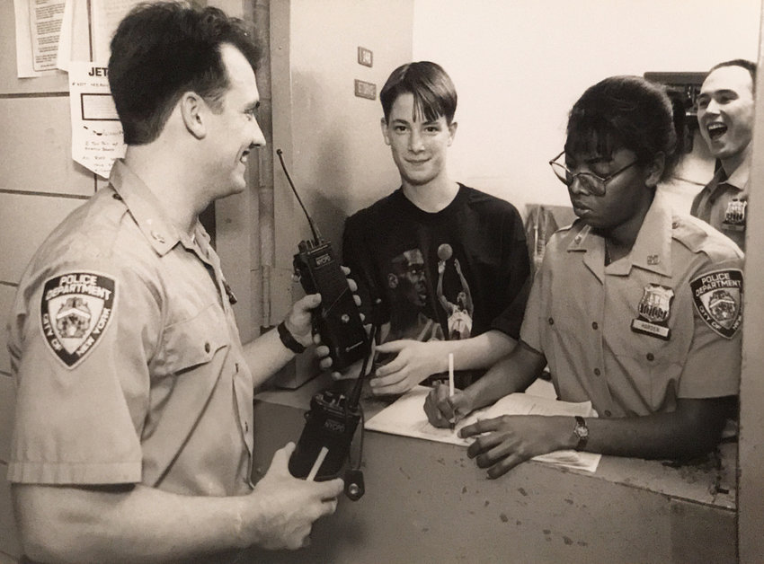 Local school student Kevin Brown was 'commissioner for a day' of the 50th Precinct back in May 1994. After a roll call and an inspection, 'Commissioner' Brown handed out radios with Officer Audrey Harden to fellow officers like Rich Gleason.
