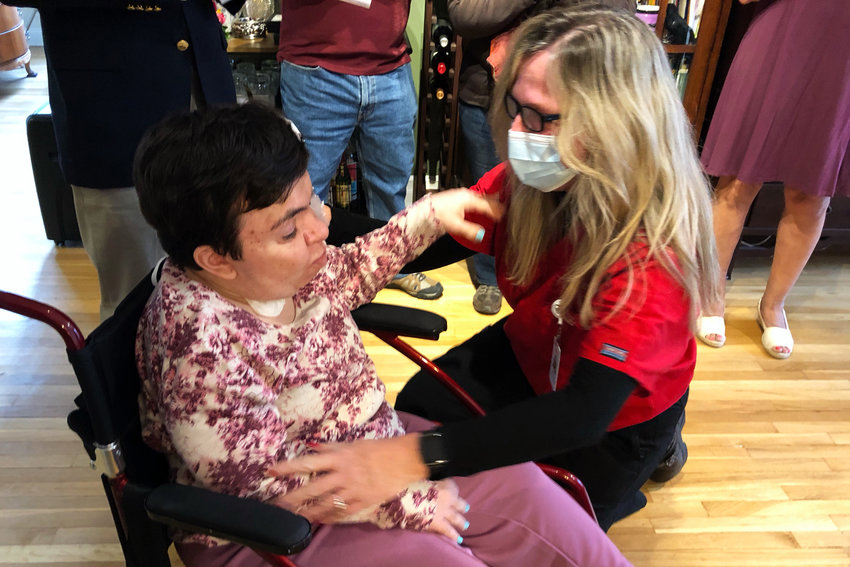 Lauren Wechsler, left, and Nancy Lonergan embrace after Lauren was presented with an honorary nursing certificate. Lauren dreamed of attending Columbia School of Nursing, but was never able to because of severe mental and physical disabilities.