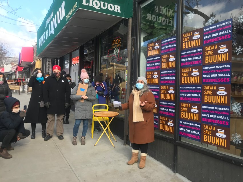 Buunni Coffee co-founder Sarina Prabasi talks to a crowd that rallied outside her 3207 Riverdale Ave., location Saturday afternoon, in the hopes to prevent the shop from closing for good on Sunday.