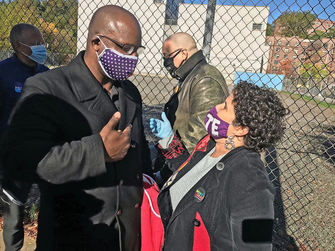Mino Lora chats with then congressional candidate Jamaal Bowman outside of IN-Tech Academy during early voting last year. Lora, who wants to replace Andrew Cohen on the city council, has joined forces with fellow candidate Jessica Haller in hopes they can win on a ranked-choice ballot March 23.