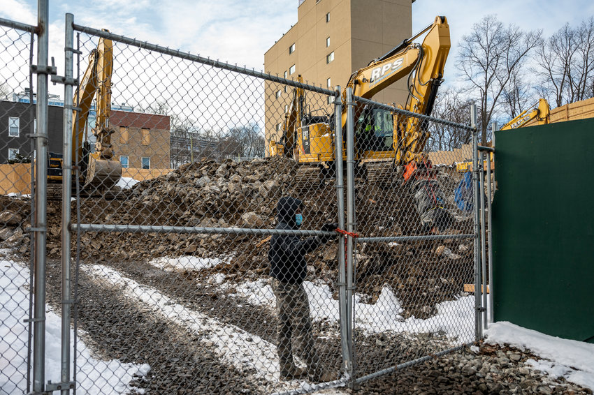 Rock chipping is expected to continue for some weeks at 5278 Post Road, where Stagg Group is erecting a seven-story residential building. Yet, for the most part, neighbors have offered few complaints.