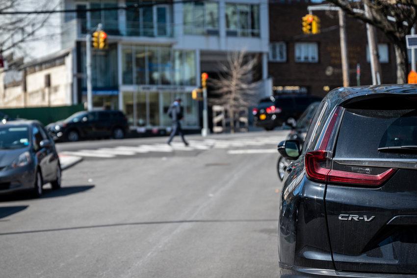 A Honda CR-V parked along W 238th St.