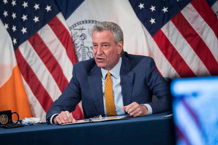 Mayor Bill de Blasio recommends everyone — including those vaccinated —wear masks indoors, but stopped short Monday of calling for a mandate.