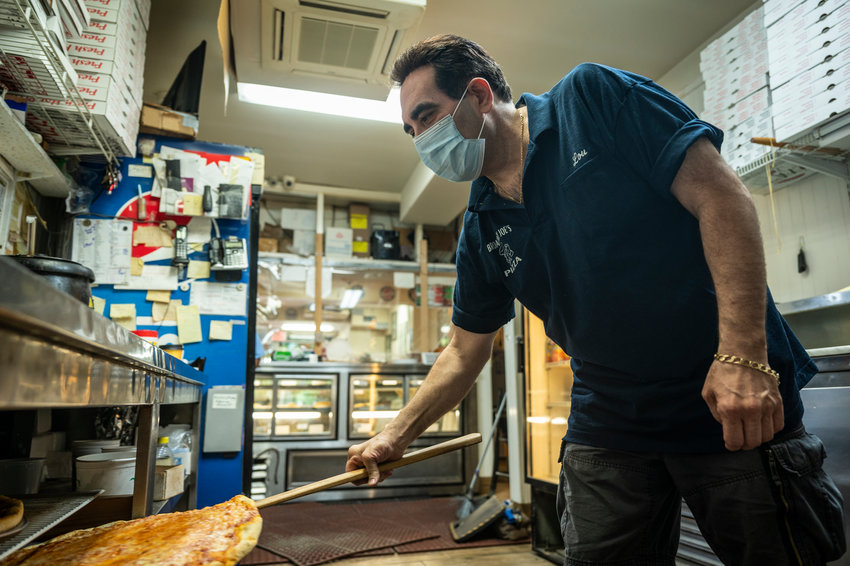 Broadway Joe's owner Louis cooks the inspiration for Mayor Bill de Blasio's voting simulation, which asks those looking to cast a ballot Tuesday to rank their top five pizza toppings.