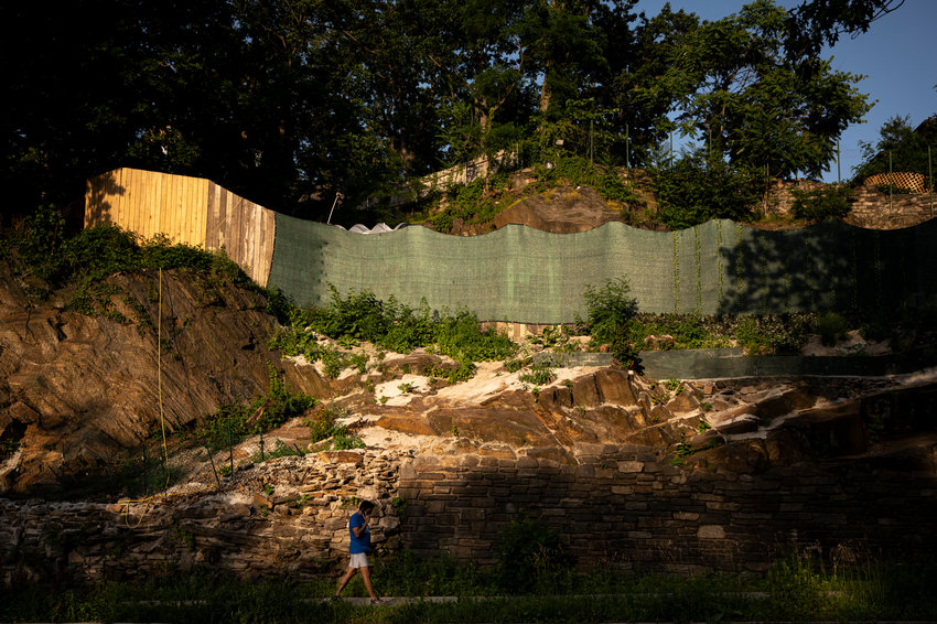 A retaining wall along the Henry Hudson Parkway East service road between West 246th and West 250th streets appears to still be crumbling after a storm last October, and just overall age. But who should fix it seems to be a point of controversy between city officials and a neighbor who lives on top of the small cliff — Alan Rosenthal.