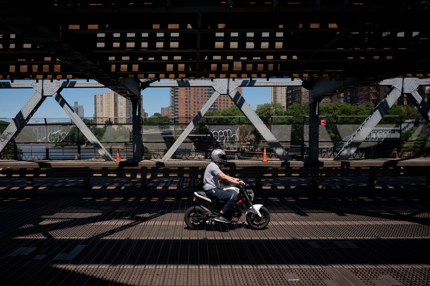 A Bronx-bound motorcyclist on the Broadway Bridge on Wednesday morning, June 23, 2021.