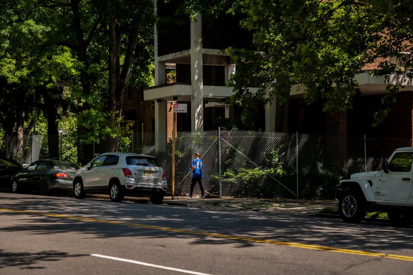 A pedestrian makes their way past the shuttered Church of the Visitation of the Blessed Virgin Mary which sits empty just across West 239th Street from Van Cortlandt Park. The city is negotiating a purchase of the property from the Archdiocese of New York, which could cost millions..