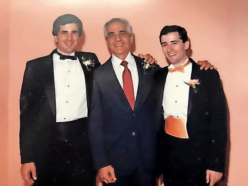 Marc Attar, here with sons Michael, left, and Alan.