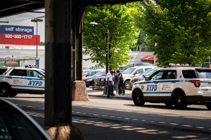 Two officers from the 50th Precinct arrest a man near West 233rd Street and Broadway on July 28. While this is not necessarily an example, precinct commander Capt. Emilio Melendez says the 5-0 has had a slight uptick in shootings, but has not experienced the same spike in violent crime as much of the city for the first half of 2021.
