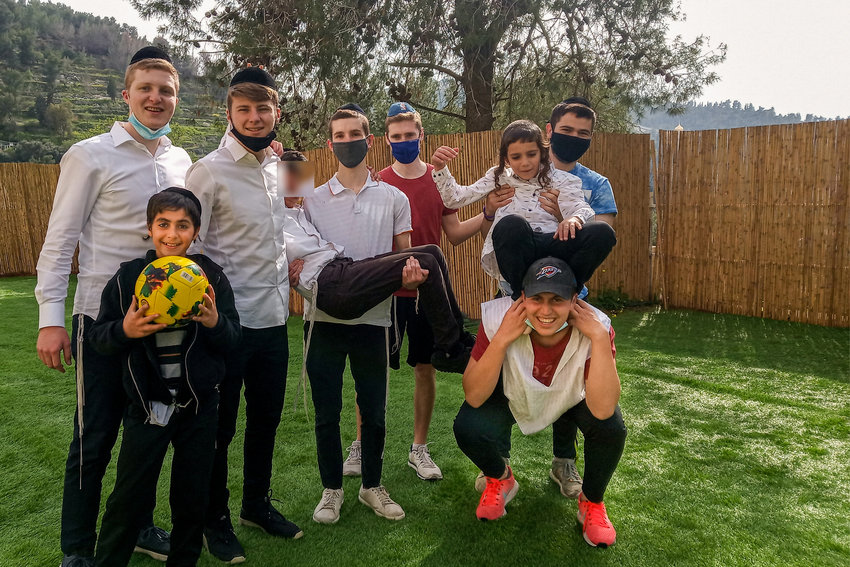 Avi Kroll, a former student at SAR High School, has volunteered in many places, but most recently traveled to Israel to help out the Sanhedria Children's Home. Kroll hosted a 'sports day' for the kids at the home over the most recent Passover holiday, giving them a chance to fill their day with soccer.