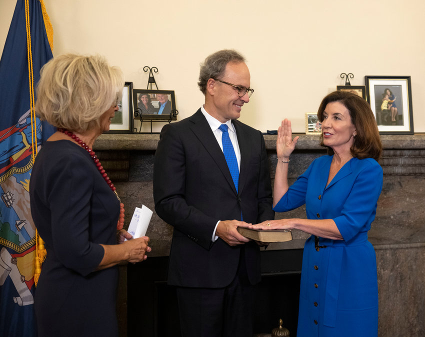 Kathy Hochul is sworn in as New York's 57th governor by chief judge Janet DiFiore while husband Bill Hochul holds the Bible. She will fill out the remainder of Andrew Cuomo's third term, who announced his resignation two weeks ago after a sexual harassment scandal rocked his office.