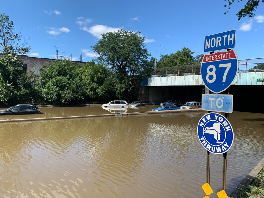 Large sections of the Major Deegan Expressway was shut down through Kingsbridge after massive flooding turned the expressway into river. Cars, trucks and even tour buses were abandoned along the way.