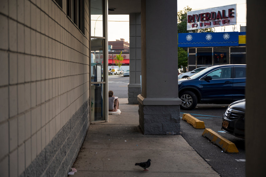 A woman sits outside of the West 238th Street Rite Aid, one of many in the city who are homeless. Some say she could be joined by so many more unless New York's now-expired eviction moratorium is not re-upped. Gov. Kathy Hochul could call for a special session to address the moratorium as early as Wednesday.