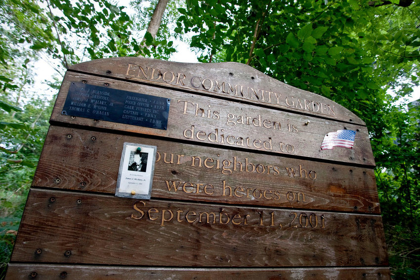 Shortly after the Sept. 11, 2001, terrorist attacks on the World Trade Center, someone constructed a wooden plaque in Fieldston's Endor Garden honoring five local first responders who died that day. But someone stole the display in 2017, leaving it empty ever since. Laura Spalter and others are set to change that Saturday with the unveiling of a new plaque in time for the 20th anniversary of 9/11.
