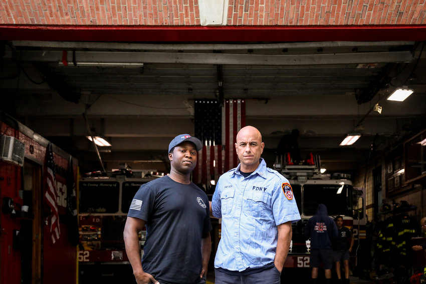 Jonathan Gilliam, left, and Capt. Anthony Rich stand outside the Ladder 52 firehouse. Both have led similar career paths leading them to the New York Fire Department, yet they have different memories of Sept. 11, 2001.