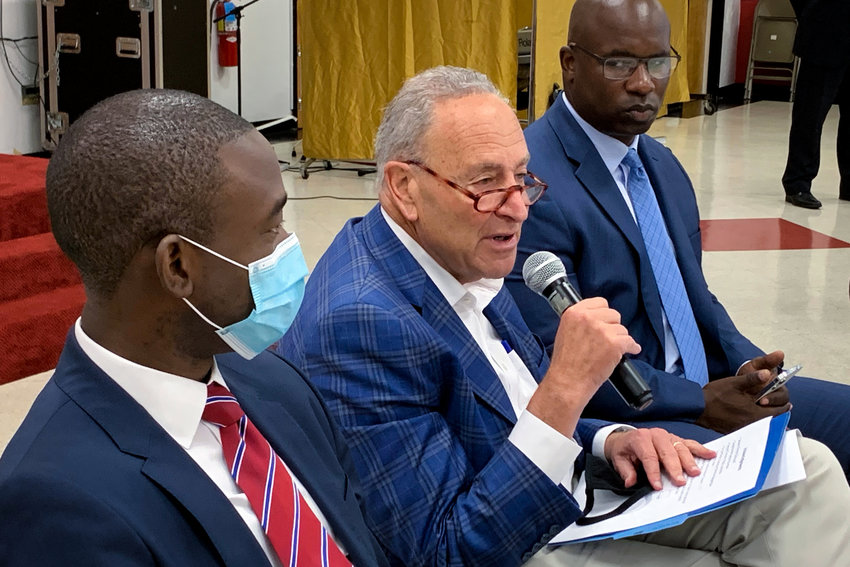 U.S. Senate Majority Leader Chuck Schumer pushes to make monthly child poverty payments that started under the American Rescue Plan permanent in a Yonkers town hall that included U.S. Treasury Department deputy secretary Wally Adeyemo, left, and U.S. Rep. Jamaal Bowman.