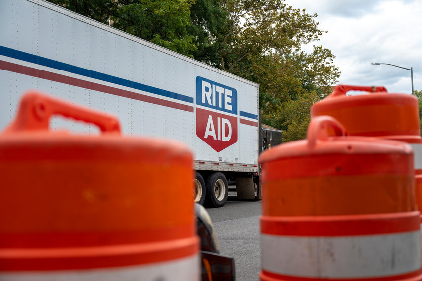 A Rite Aid merchandise truck parked outside the Knolls Crescent location.