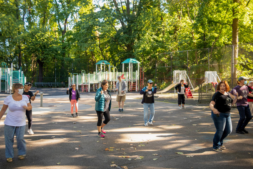 Daniela Del Giorno leads one of Silver Shoes Dance Club's free classes at Van Cortlandt Park's Classic Playground, across the street from the Amalgamated Houses. Del Girono founded Silver Shoes to help those over 55 to stay physically healthy and mentally sharp as they age.