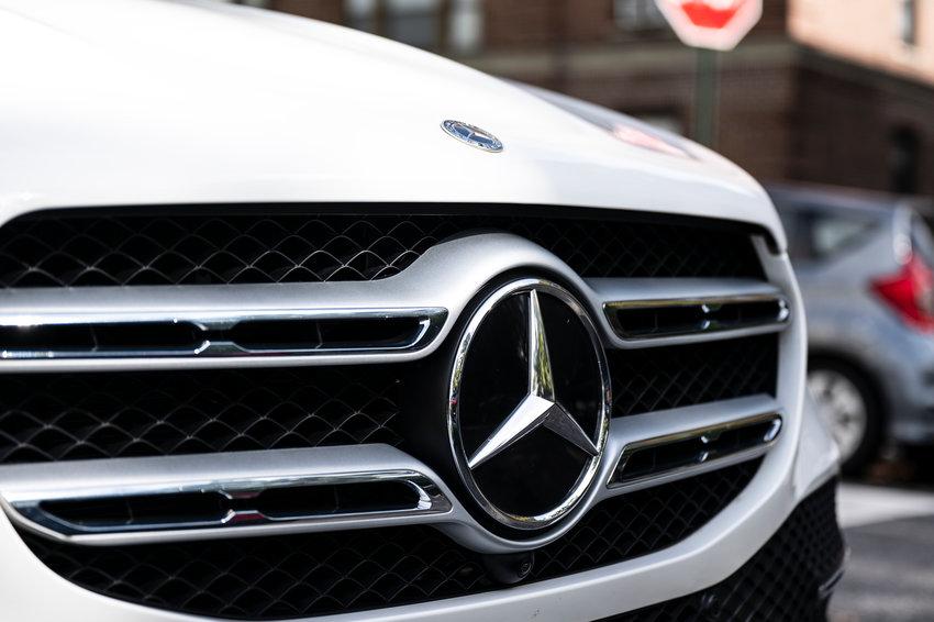 A brand emblem on a Mercedes Benz car.