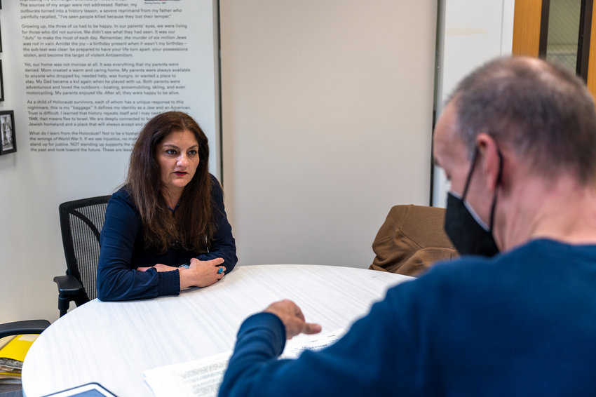 Afridi discusses course work with a colleague at the Holocaust, Genocide and Interfaith Center at Manhattan College.