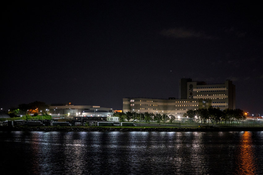 The massive jail facility of Rikers Island looms across the East River, even from Barretto Point Park. Mayor Bill de Blasio has pushed to spend billions of dollars to close the facility, but what's happening behind those walls in the meantime?