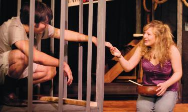 EMILY WALTON, playing the role of Meredith Parker, reaches out to Bat Boy, played by Drew Lewis. Photo by Raffi Holoszyc-Pimentel